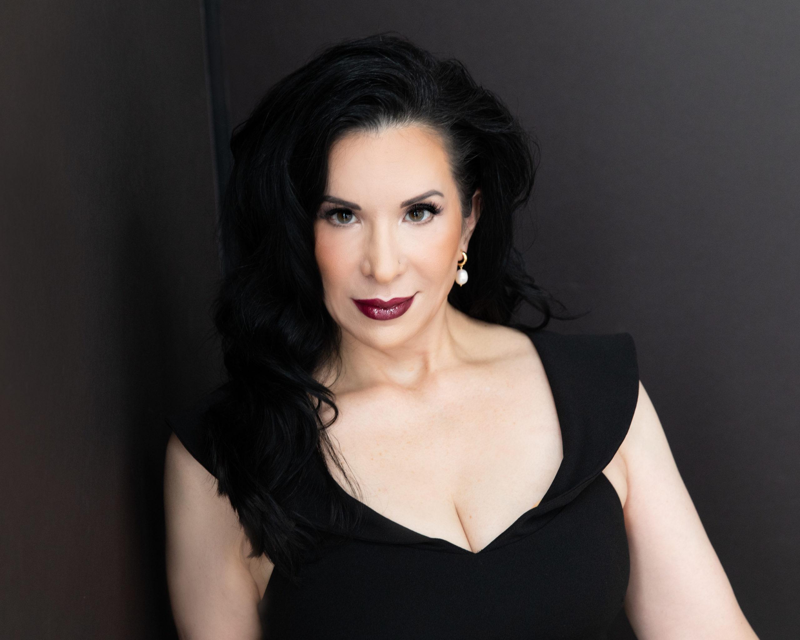Alina Sholar posing with isolated black background