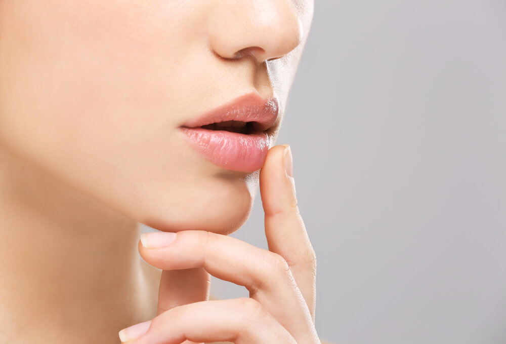 woman touching lip