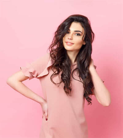 woman dressed in pink on pink background